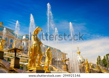 amazing beautiful landscape old historical garden building palace golden sculpture statues and fountains spray water Peterhof city saint petersburg north country russia UNESCO world heritage luxury  - stock photo