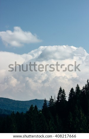 amazing beautiful view of mountains hills and valley on background of blue sky and clouds