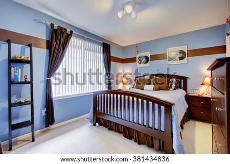 Amazing bedroom with white carpet and periwinkle bedding matching the walls. - stock photo