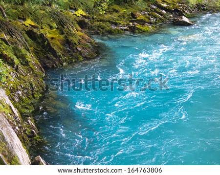 Amazing Blue River Water at Mount Aspiring National Park, New Zealand - stock photo