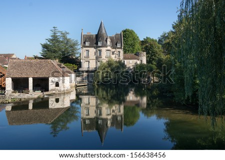 Amazing Castle near the small picturesque waterfall in Moret-sur-Loing. Moret-sur-Loing is a commune in Seine-et-Marne department in the Ile-de-France region in France.