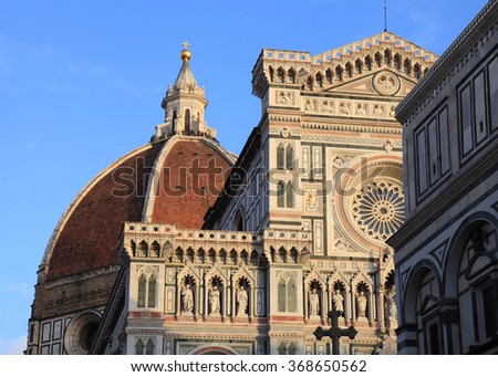 Amazing Cathedral of Santa Maria del Fiore (Il Duomo di Firenze), Florence, Italy. The basilica is one of Italy's largest churches, UNESCO World Heritage Site. Sunset light - stock photo