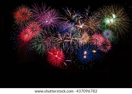 Amazing celebration multicolored sparkling fireworks.  4th of July beautiful fireworks. Independence Day, Canada Day, New Year holidays salute. - stock photo