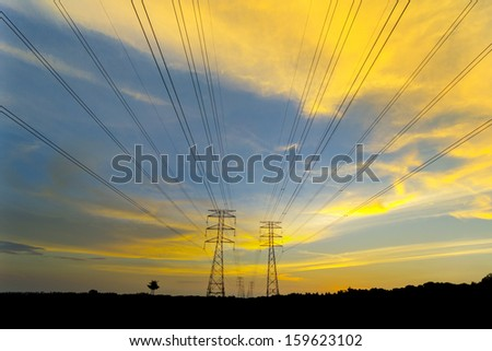 amazing color cloud via sunset with silhouette pylon tower
