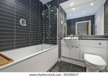 Amazing contemporary bathroom with rectangular gray ceramic tiles - stock photo