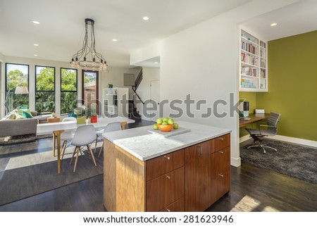 Amazing contemporary luxurious home with office, kitchen island, table, couch and open floor plan. - stock photo