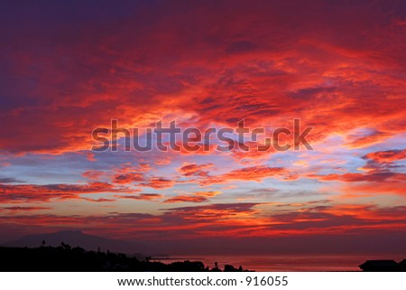 Amazing deep red sky and clouds of sunrise in Spain - stock photo