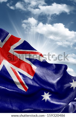 Amazing Flag of Australia with a beautiful blue sky as the background - Oceania - stock photo