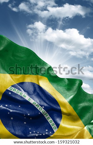 Amazing Flag of Brazil with a beautiful blue sky as the background - Latin America - stock photo