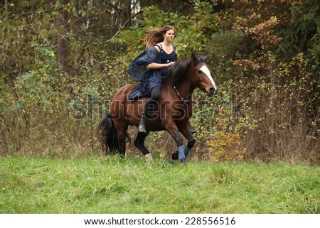 Amazing girl with horse running without bridle and saddle in nature