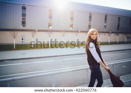 amazing  happy  blonde woman walking outdoors