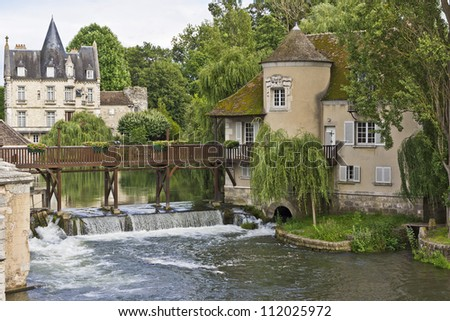 Amazing house near the small picturesque waterfall in Moret-sur-Loing. Moret-sur-Loing is a commune in Seine-et-Marne department in the Ile-de-France region in France.