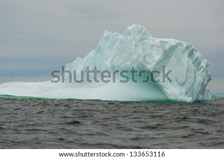 Amazing iceberg in the open waters off the coast of Newfoundland - stock photo