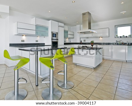 amazing modern penthouse kitchen with breakfast bar - stock photo