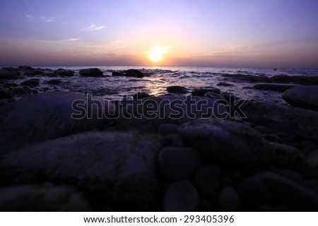 Amazing morning sunrise over the sea with overcast sky. - stock photo
