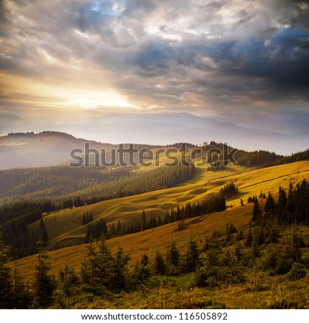 amazing mountain sunset with red clouds - stock photo
