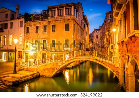 Amazing narrow canal in Venice in the evening, Italy - stock photo