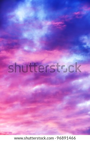 Amazing nature background: dramatic and moody pink, purple and blue cloudy sunset sky shot vertical. - stock photo