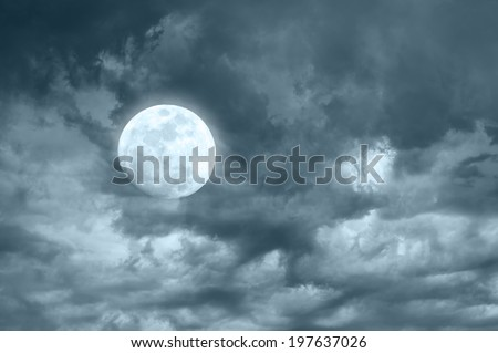Amazing night sky with shining full moon and dramatic clouds - stock photo