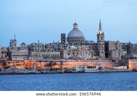 Amazing night view from the sea on the harbor of Valletta, Malta. - stock photo