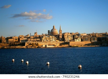 Amazing panoramic view of Valletta, capital city of Malta - small island country and popular tourist destination in Mediterranean Sea, on sunny summer day with the city´s skyline in background