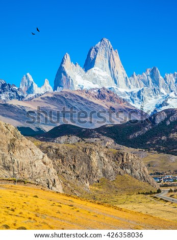 Amazing Patagonia in February. The white tops of Fitzroy rocks covered the midday sun.