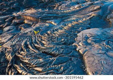 Amazing patterns and textures of molten cooled lava landscape in Hawaii Volcanoes National Park, Big Island, Hawaii - stock photo