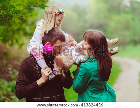 Amazing picture of the young happy family - stock photo