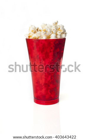 Amazing red glass of popcorn isolated on a white background