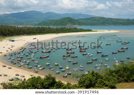 Amazing scene at fishing village in Phu Yen, Viet Nam, crowded of circle boat floating on water, valley of fishing boat at Vietnam channel, group of coracle in panoramic view, beautiful seascape