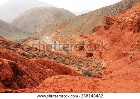 Amazing scenic red mountain valley, canyon Uchterek, Kyrgyzstan. - stock photo