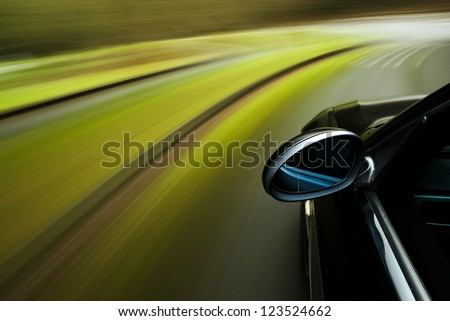 Amazing side view of black car in turn - stock photo