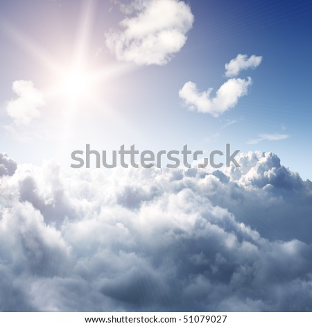 Amazing skyline view from airplane window - sun and clouds - beautiful background - stock photo