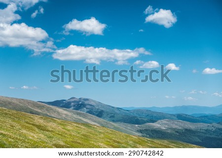 Amazing spring ukrainian mountains under blue sky with clouds- Svydovets range, Carpathians, West Ukraine - stock photo