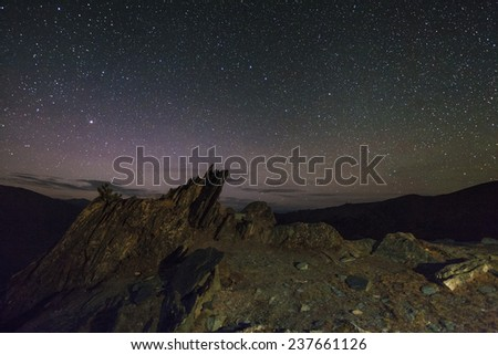 Amazing starry night in the high mountains - stock photo