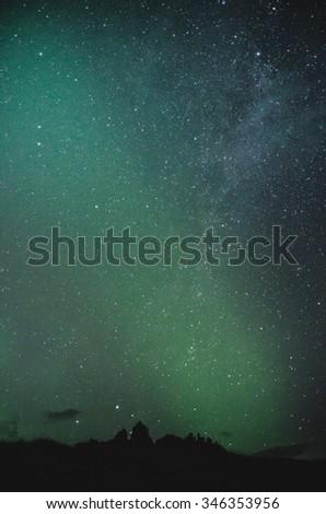 amazing starry night sky above the horizon - stock photo