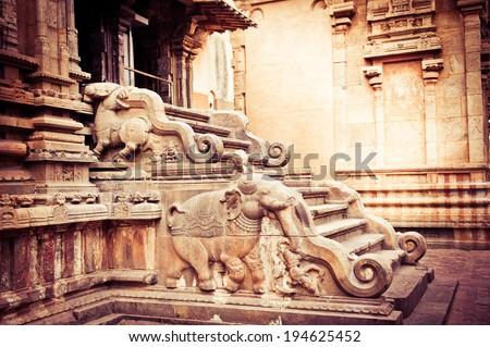 Amazing stone bas relief on stepladder of main tower at Hindu Brihadishvara Temple. South India, Tamil Nadu, Thanjavur (Trichy) - stock photo