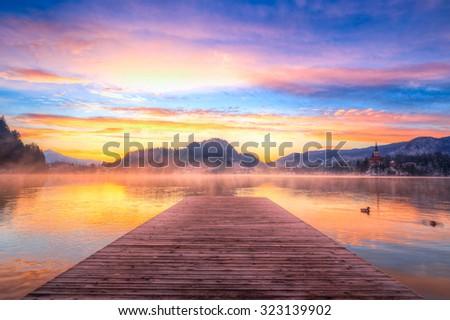 Amazing sunrise at the lake Bled in winter, Slovenia, Europe - stock photo