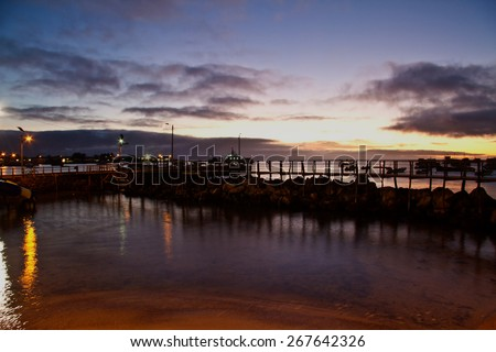 Amazing sunset along the port in San Cristobal island, Galapagos, Ecuador - stock photo
