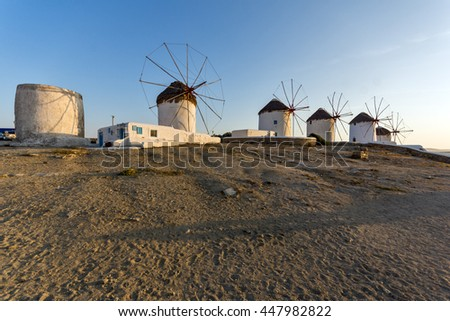 Amazing Sunset and White windmills on the island of Mykonos, Cyclades, Greece - stock photo