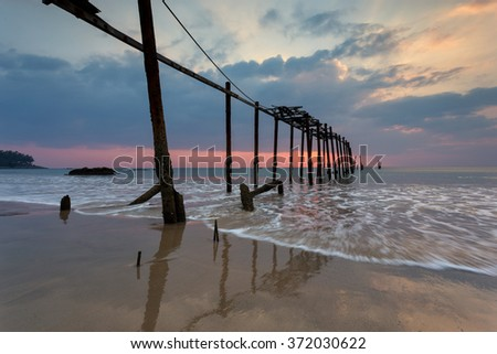 Amazing sunset during low tide on Pilai beach in Phang Nga province in Thailand - stock photo