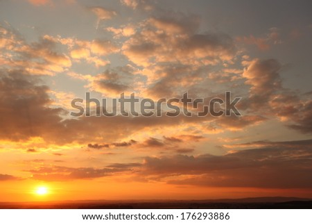 Amazing Sunset with cloudy sky - stock photo