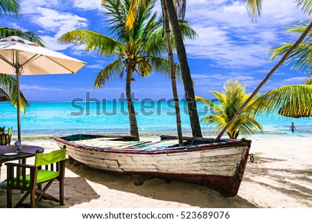 amazing tropical holidays. Beach restaurant with old boat. Mauritius island
