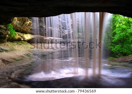 Amazing view from behind Lasalle Falls of Starved Rock State Park in central Illinois - stock photo