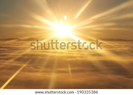 Amazing view from plane on the orange sky, sunset sun and clouds - stock photo