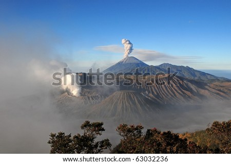 Amazing view of active volcanoes with gas eruption, Mountain Bromo at sunrise, Indonesia.