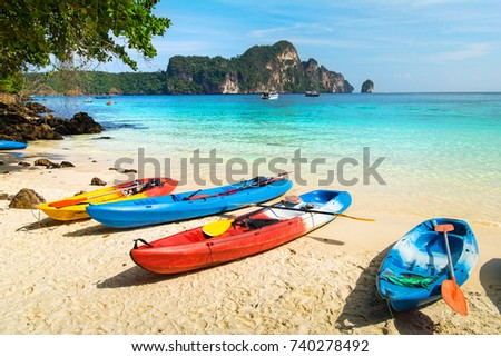 Amazing view of beautiful beach with kayaks on the sand. Location: Phi Phi Island, Krabi province, Thailand, Andaman Sea. Artistic picture. Beauty world.