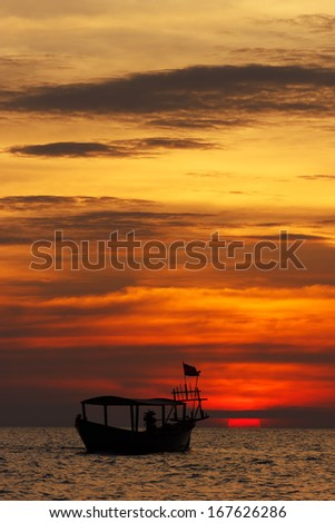 Amazing view of fishing boat at sunset in Cambodia - stock photo