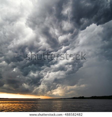 Amazing view of gorgeous thunderstorm clouds above water