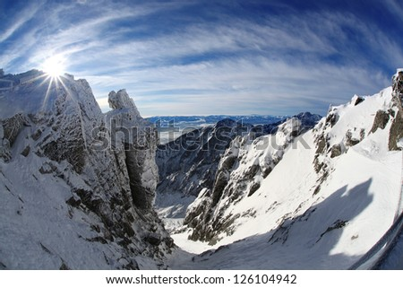 Amazing view of High Mountains against sun - stock photo